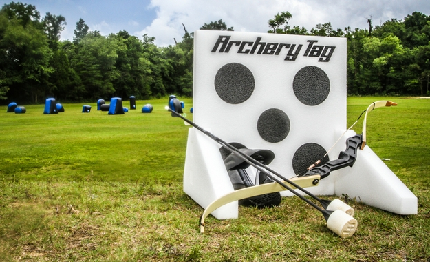 A photo of a target, bow and arrow for Camp Canaan's Archer Tag set.