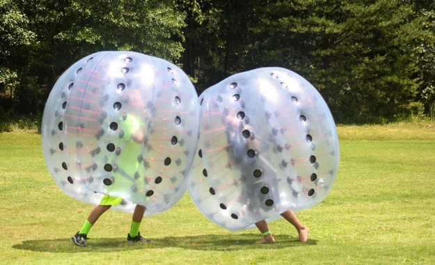 Two people playing Bubble Soccer at Camp Canaan located in Rock Hill, South Carolina