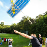 A person launches a paper airplane into the air.