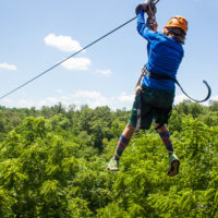 A counselor zip lining.