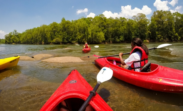 A photo of kids kayaking on the Catawba River